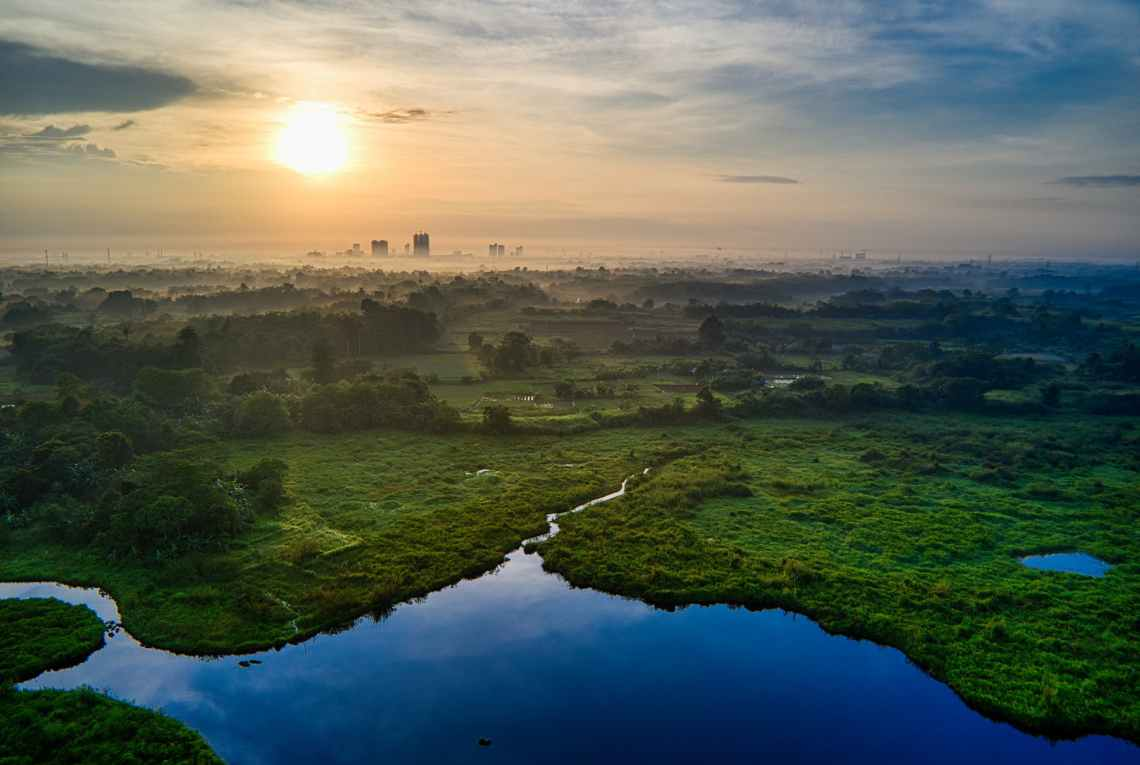 aerial photography of landscape with view of sunset